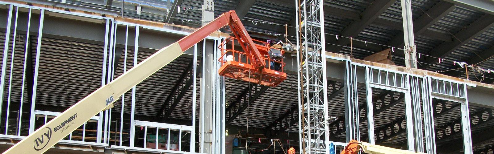 construction crane next to half developed building structure