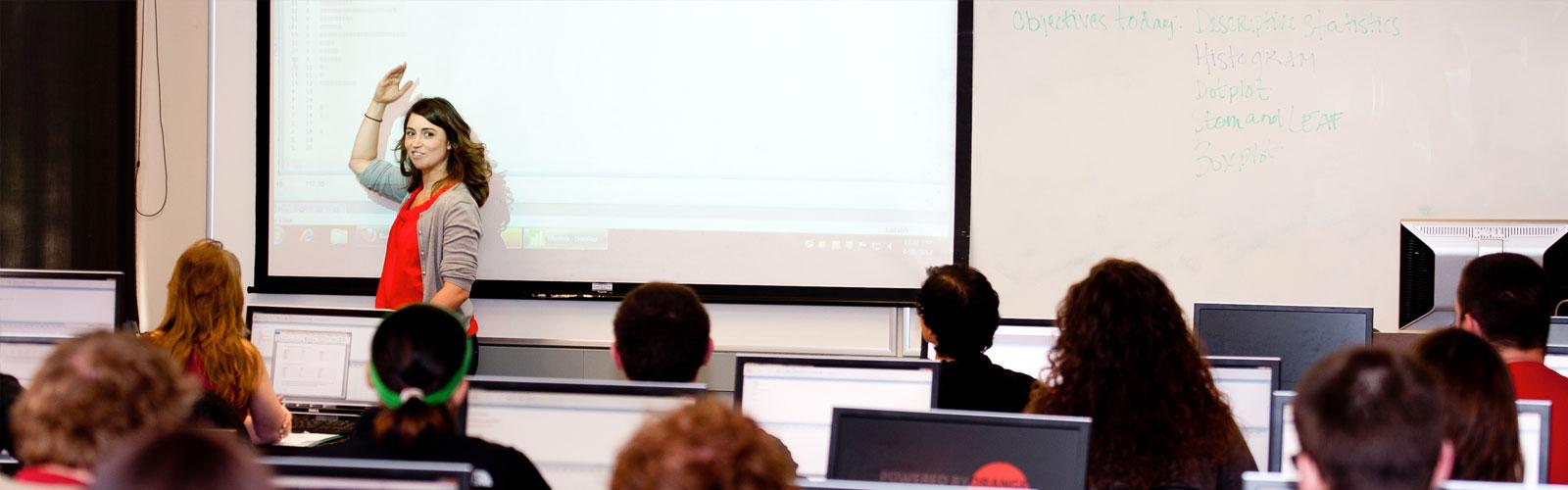 woman teaching large class