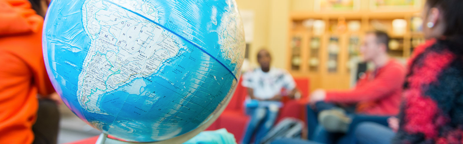world globe sitting on a table in a classroom
